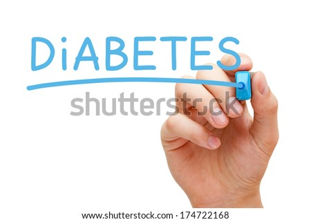 Hand writing Diabetes with blue marker on transparent wipe board.