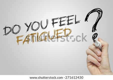Hand writing do you feel fatigued on grey background - stock photo