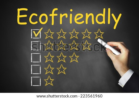 hand writing ecofriendly on black chalkboard golden star rating