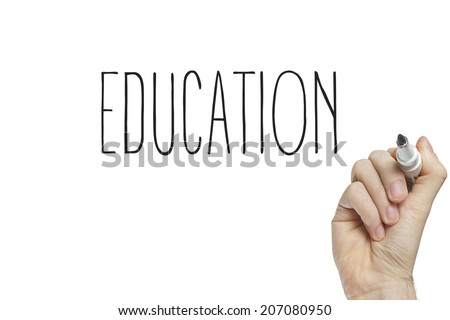 Hand writing education on a white board - stock photo