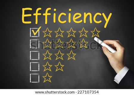 hand writing efficiency on black chalkboard golden rating stars