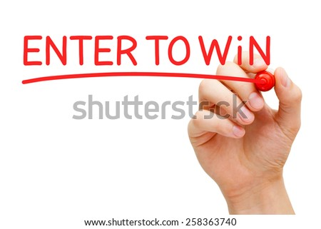 Hand writing Enter to Win with red marker on transparent wipe board. - stock photo