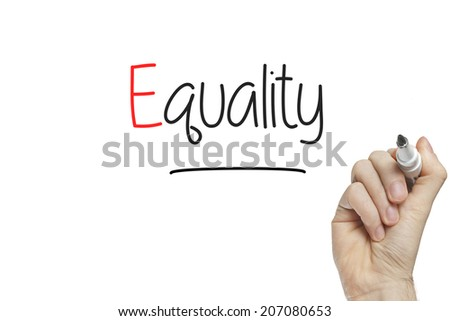 Hand writing equality on a white board