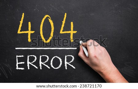 hand writing 404 error on a chalk board - stock photo