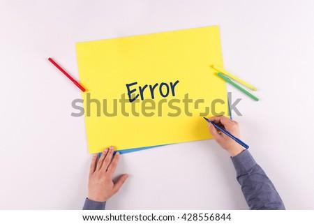 Hand writing Error on yellow paper - stock photo