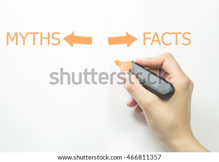 Hand writing Facts vs myths with marker on transparent wipe board.