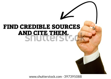 """Hand writing """"Find credible sources and cite them"""". on a transparent wipe board. - stock photo"""