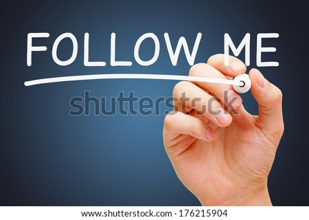 Hand writing Follow Me with white marker on transparent wipe board. - stock photo