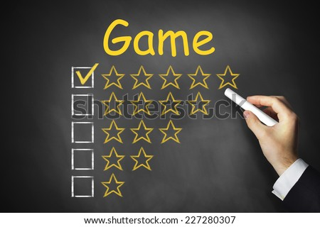 hand writing game on black chalkboard golden star rating