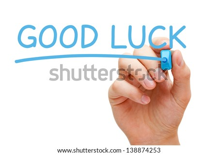 Hand writing Good Luck with blue marker on transparent wipe board.