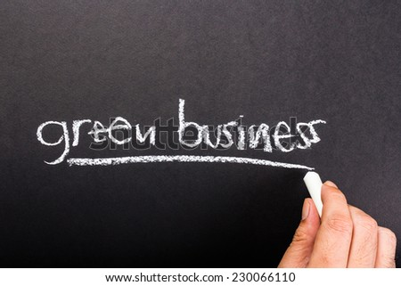 Hand writing Green Business topic on chalkboard