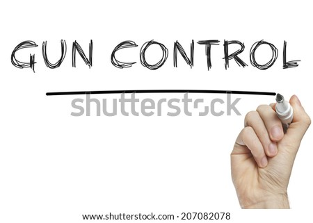 Hand writing gun control on a white board - stock photo