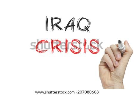Hand writing iraq crisis on a white board - stock photo