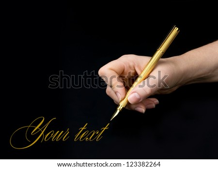 Hand writing isolated on the black background. - stock photo