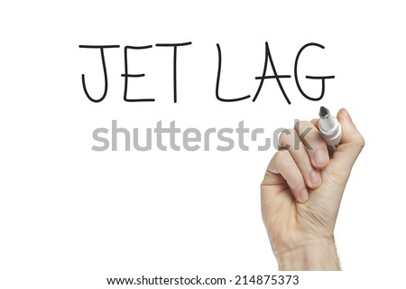 Hand writing jet lag on a white board