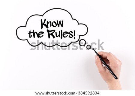 Hand writing KNOW THE RULES! on white paper, View from above - stock photo