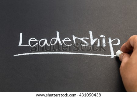 Hand writing Leadership word topic on chalkboard