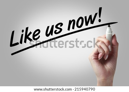 Hand writing like us now with black marker - stock photo