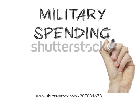 Hand writing military spending on a white board