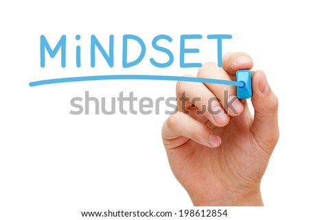Hand writing Mindset with blue marker on transparent wipe board. - stock photo