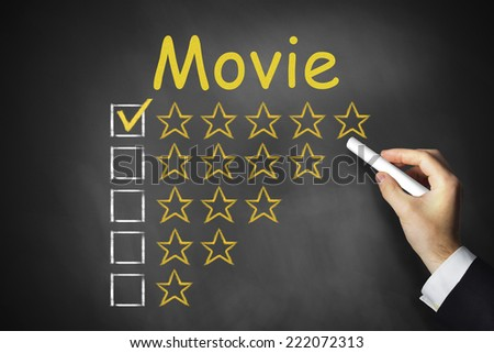hand writing movie on black chalkboard rating stars ranking
