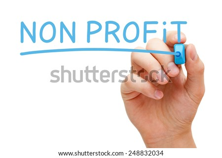 Hand writing Non Profit with blue marker on transparent wipe board isolated on white. - stock photo