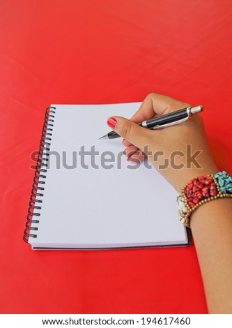 hand writing notebook on red background