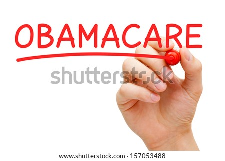 Hand writing ObamaCare with red marker on transparent wipe board. - stock photo