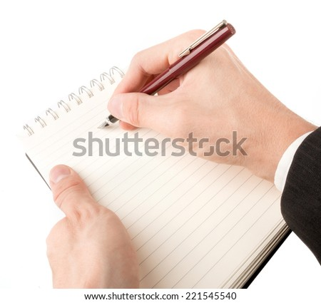 Hand writing on an empty journal binder (notepad or notebook) isolated on white - stock photo