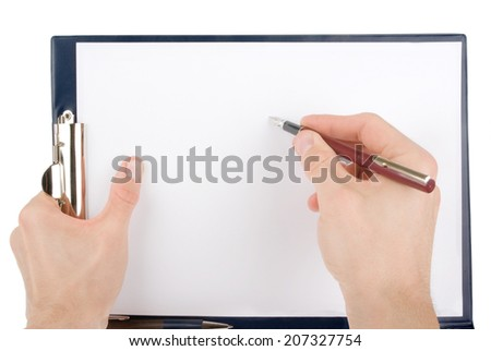 Hand writing on an empty paper in a clipboard isolated on white