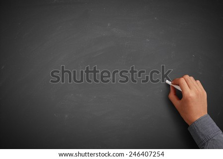 Hand writing on blank blackboard or background. - stock photo