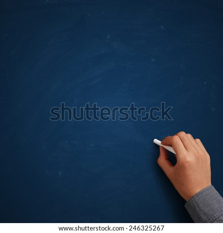 Hand writing on blank blue chalkboard or background.