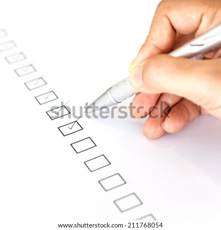 Hand writing on blank checkbox - stock photo