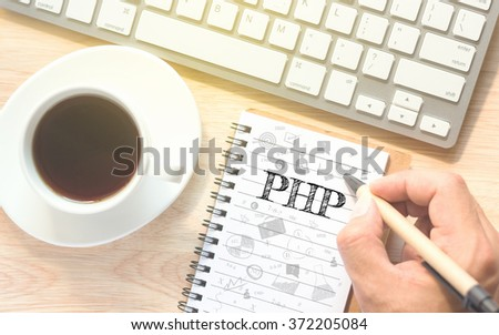 Hand writing on book message PHP. A keyboard and a glass coffee table.Vintage tone. - stock photo
