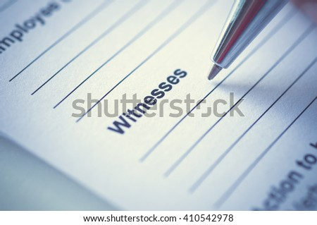 Hand writing on incedent witnesses form. - stock photo