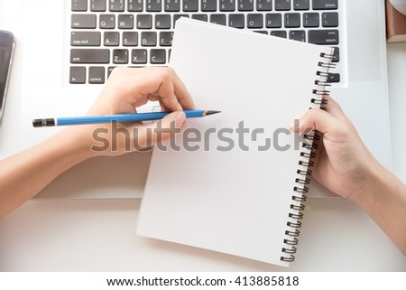 hand writing on the paper on desk office. - stock photo