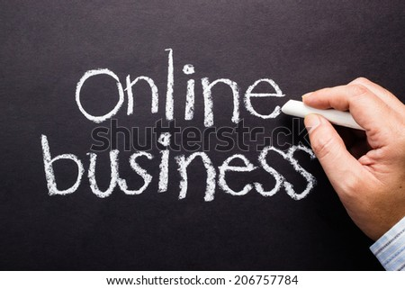Hand writing Online business topic with chalk