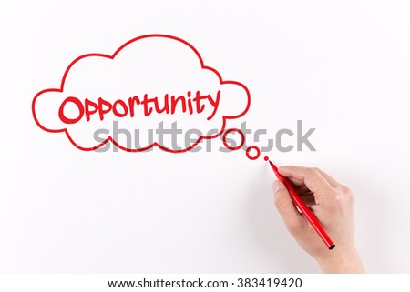 Hand writing Opportunity on white paper, View from above - stock photo