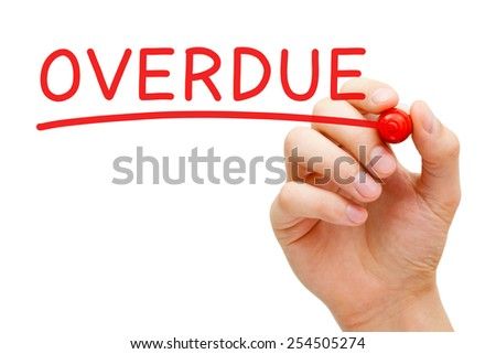 Hand writing Overdue with red marker on transparent wipe board. - stock photo