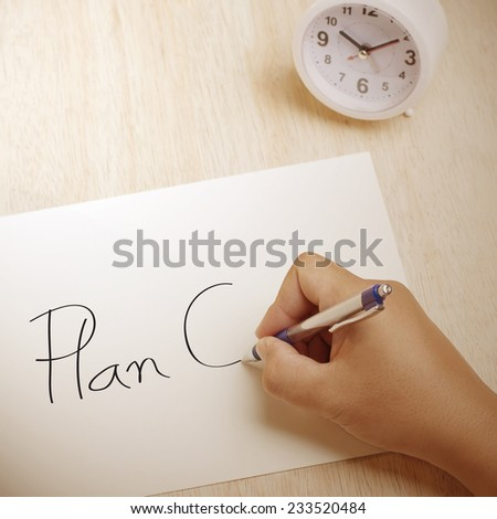 Hand writing Plan C on paper sheet - stock photo