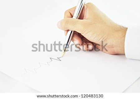 Hand writing pulse line in white paper - stock photo