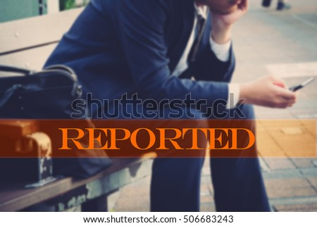 Hand writing reported with the abstract background. The word reported  represent the action in business as concept in stock photo.