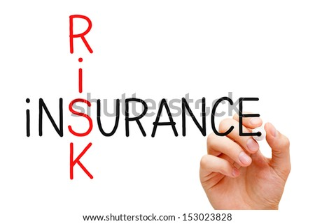 Hand writing Risk Insurance crossword with marker on transparent wipe board. - stock photo