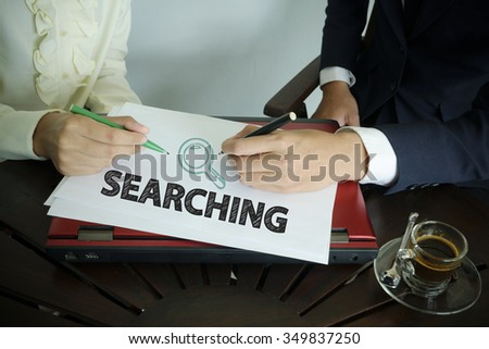 hand writing SEARCHING text with two business person ,  team work concept - stock photo