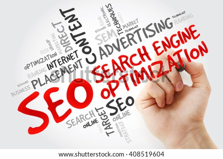 Hand writing SEO (search engine optimization) word cloud business concept - stock photo