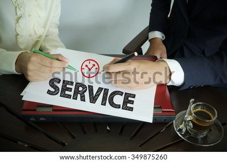hand writing SERVICE text with two business person , business concept , business idea , team work concept - stock photo