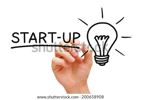 Hand writing Start-up concept with black marker on transparent wipe board. - stock photo