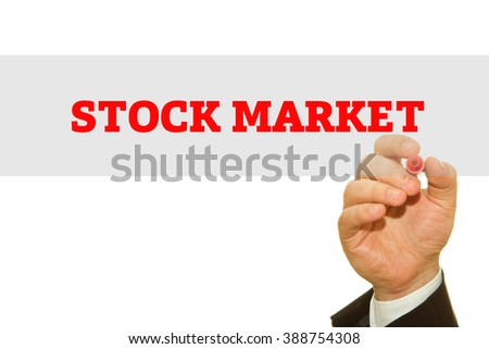 Hand writing Stock Market message on a transparent wipe board.