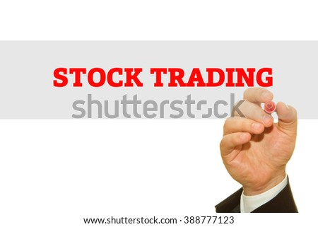Hand writing Stock Trading on a transparent wipe board.
