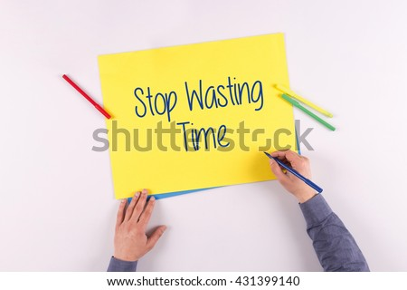 Hand writing Stop Wasting Time on yellow paper - stock photo